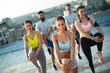 canvas print picture Group of happy fit friends exercising outdoor in city