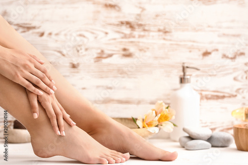 Young woman after spa pedicure treatment in beauty salon