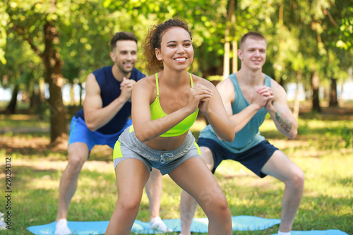 Group of young sporty people training together outdoors Fototapeta