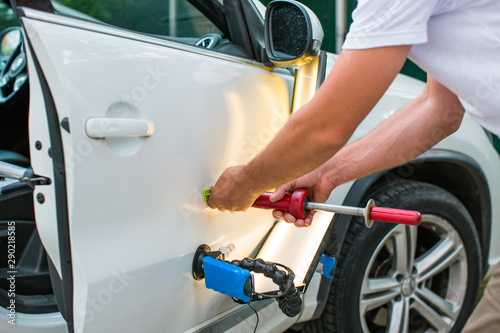 Fototapeta  Repairing car dent after the accident by paintless dent repair