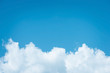 canvas print picture - Cumulus humilis clouds in the blue sky, view from below