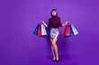 canvas print picture Photo of beautiful stylish lady holding many packs in hands send air kiss wear trendy outfit isolated purple background