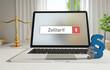 Zolltarif – Laptop Monitor im Büro mit Begriff im Suchfeld. Paragraf und Waage. Recht, Gesetz, Anwalt.