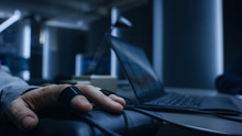 Close-up Shot Of The Suspect's Hand Connected To The Lie Detector / Polygraph Test Machine, While Female Special Agent Conducts Questioning.