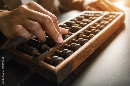 Fototapeta Asian woman hands accounting with old abacus. Financial design concept. obraz