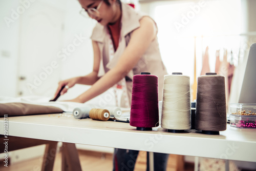 Closeup of colorful thread with fashion designer background in workshop studio Canvas