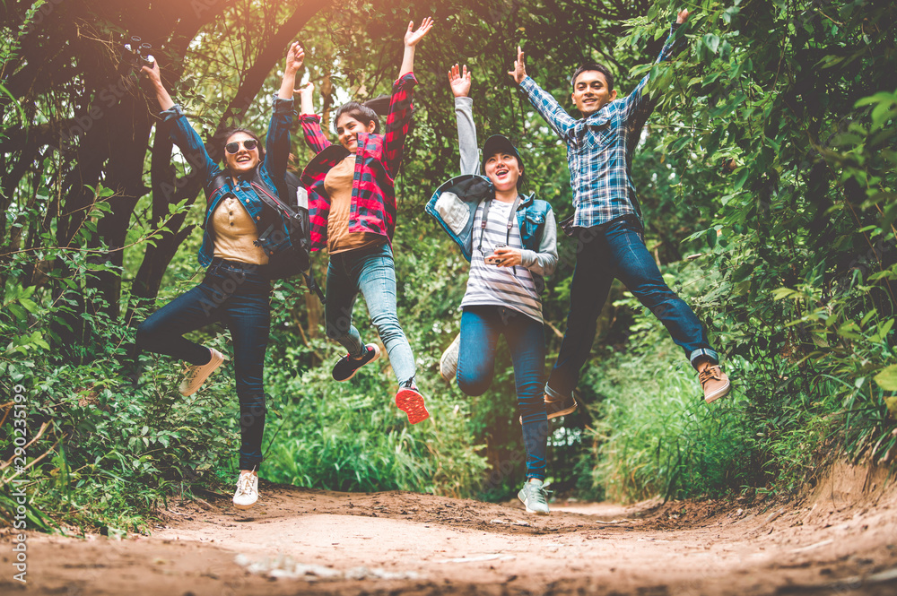 Fototapety, obrazy: Group of happy Asian teenage adventure traveler trekkers group jumping together in mountain at outdoor forest background. Young hiker friends supporting each others as survival team travel and success