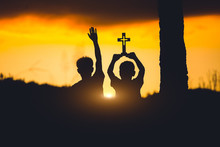 Silhouette Of Two Young Christ...