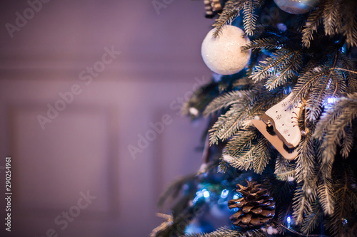 Recess Fitting Macro photography Decorated Christmas tree with ornaments, stars, hearts.