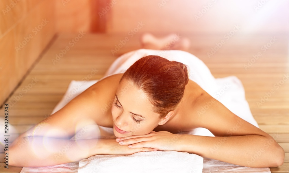 Fototapeta Young woman relaxing in spa.Healthcare and beauty concept.