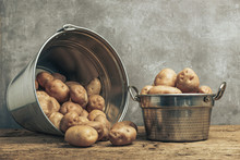 Fresh Potatoes In Silver Baske...