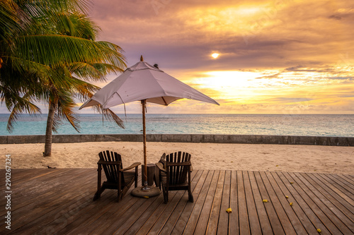 Fototapety, obrazy: Umbrella and deck chairs on the beautiful tropical beach and sea at sunset time for travel and vacation