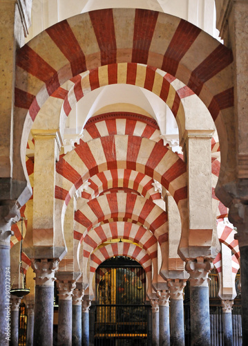 Arab horseshoe arches inside the Mosque of Cordoba (Mezquita de Córdoba) World Heritage Site by Unesco, one of the most famous monuments of Andalusia and Spain