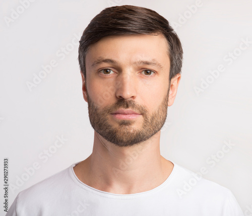 Obraz Portrait Of Man Looking At Camera Over White Background - fototapety do salonu