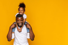 Happy African American Father And Daughter Having Fun