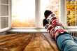 canvas print picture Autumn socks and open fall window background. Free space for your decoration.