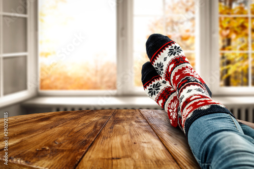 Stampa su Tela  Autumn socks and open fall window background