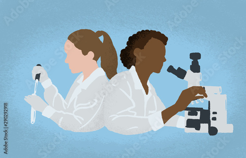 Fotografía  Women scientists wearing white coats conducting experiments in science laboratory