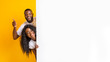 canvas print picture - African couple posing with white empty board