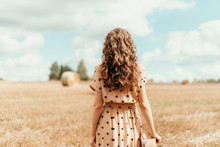 Woman In Beige Polka Dot Dress...