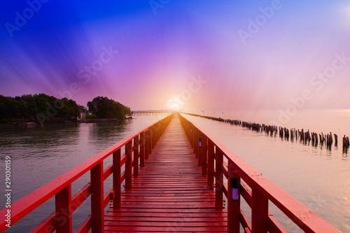 Long Red Bridge sunlight sky tree at beach sea,Red bridge Samut Sakhon Thailand