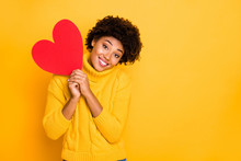 Photo Of Cute Charming Nice Sweet Attractive Black Curly Girlfriend Wearing Yellow Sweater Holding Big Red Heart With Her Hands Isolated Over Vivid Color Background
