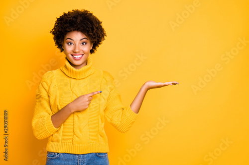Aluminium Prints Equestrian Photo of pretty dark skin lady promoter holding on arm best product for final low price wear warm jumper isolated yellow background