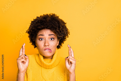 Photo of dark skin lady crossing fingers afraid to fail final exam wear warm knitted pullover isolated yellow background