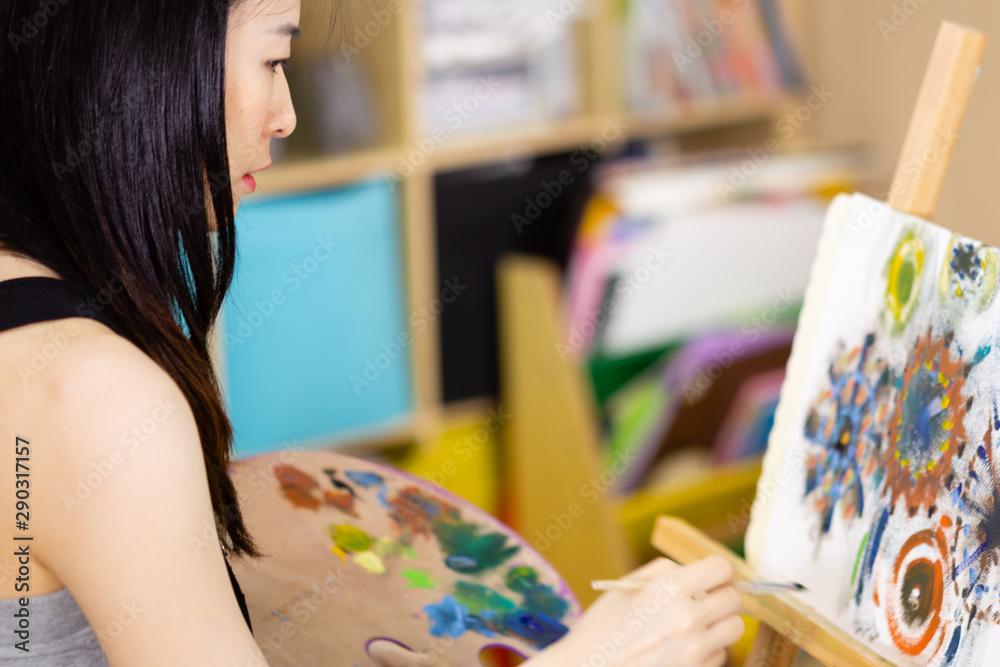 Fototapeta Artist painting oil painting on an easel