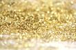 Leinwanddruck Bild Gold (bronze) glitter shine dots confetti. Abstract light sparkle defocus backgound.