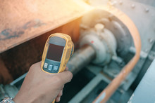 Hand Holding Of Infrared Thermometer Inspection Temperature Machinery For Preventive Maintenance In Factory