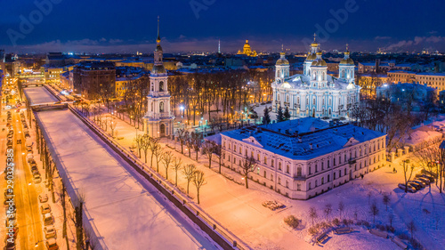 Fototapety, obrazy: Russia. Saint-Petersburg. Panorama of the evening city with a drone. Winter in St. Petersburg. Nikolsky Cathedral illuminated at night. Kryukov canal. St. Petersburg Orthodox Cathedral.