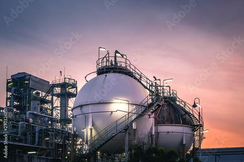 Gas storage sphere tanks in factories on sunset sky background Tapéta, Fotótapéta