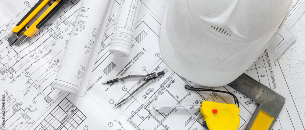 Fototapeta architect design working drawing sketch plans blueprints and making architectural construction model in architect studio,flat lay long banner