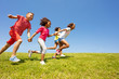 canvas print picture - Diverse group of happy kids run in park hold hands