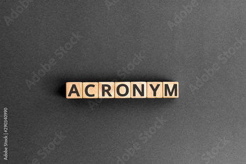 Photo acronym - word from wooden blocks with letters, use of acronyms in the modern wo
