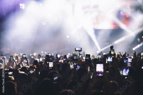 People taking photographs with touch smart phone during a music entertainment public concert - 290347556