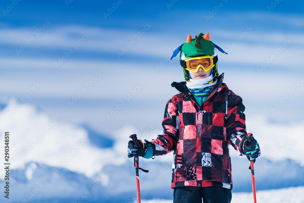 Fototapety, obrazy: Skiing Boy on a Mountain Top