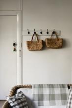 Woven Natural Fibre Baskets On Wall Hooks