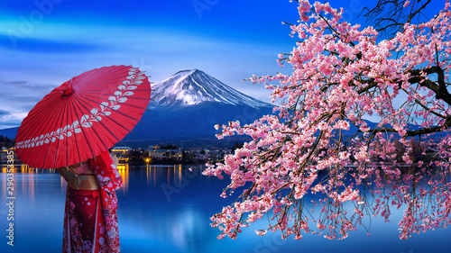 Asian woman wearing japanese traditional kimono at Fuji mountain and cherry blossom, Kawaguchiko lake in Japan Canvas Print