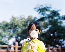 Asian Little Girl Eating Cotto...