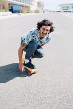 Stylish Cheerful Man Riding Skateboard