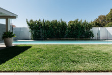 Lineal Composition Of Lap Pool And Grass In A Luxury Home