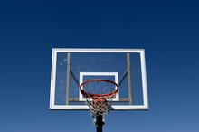 Basket Ball Hoop And Backboard Against A Blue Sky