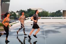 Three Runners Training In The City