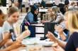 Mall: Women Talking In Busy Food Court