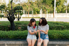2 Asian Girls With Red Rose In...