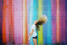 Teenager Girl Against Brightly Colored Walls Wearing Sunglasses On Film