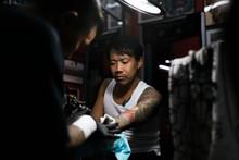 Professional Asian Tattooer Makes A Tattoo.