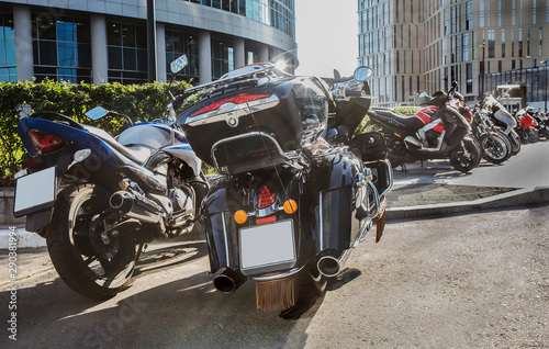 motorcycles on parking in city